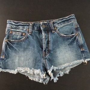 Free People button fly raw hem denim shorts